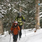 An image of Erica and Ty skinning up the Catamount Trail along the edge of a glade