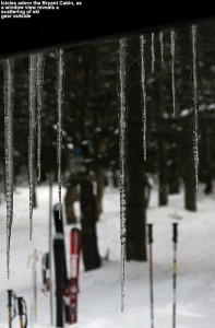 An image of icicles outside one of the windows of the Bryant Cabin on the Nordic & backcountry network at Bolton Valley Ski Resort in Vermont