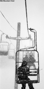 An image taken while riding the Mid Mountain Chair at Bolton Valley Ski Resort in Vermont showing heavy snowfall obscuring the view