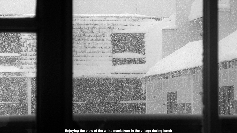 A view out the window of the base lodge at very heavy snowfall hitting Bolton Valley Ski Resort in Vermont