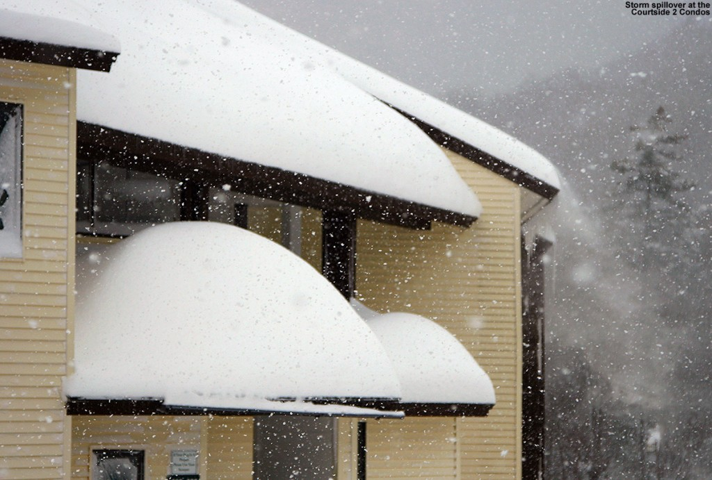 An image of deep snow accumulating on the Courtside 2 Condominiums during a big snowstorm at Bolton Valley Ski Resort in Vermont