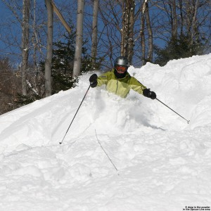 An image of Erica skiing deep powder on Spruce Line at Stowe Mountain Resort in Vermont