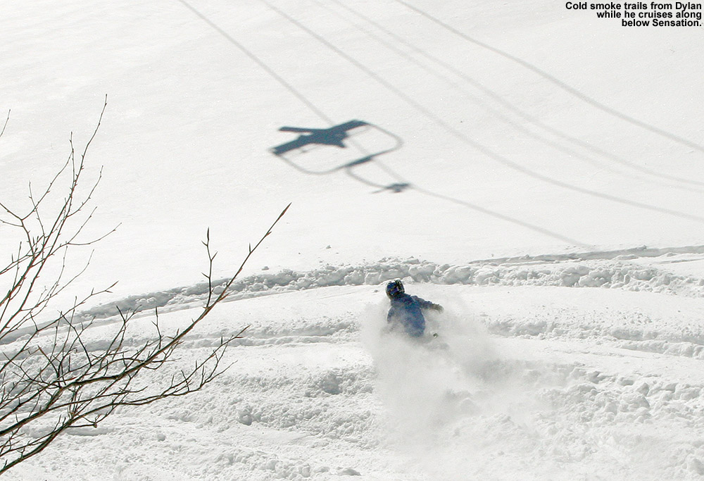 An image of Dylan cruising through the powder below the Sensation Quad Chairlift at Stowe Mountain Ski Resort in Vermont