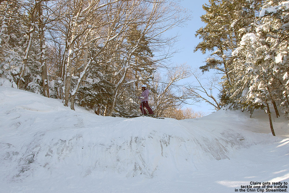 An image of Claire atop one of the waterfalls in the Chin Clip Streambed at Stowe Mountain Ski Resort in Vermont