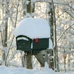 An image of our mailbox in Waterbury, Vermont in the morning with a fresh stack of snow from overnight snowfall