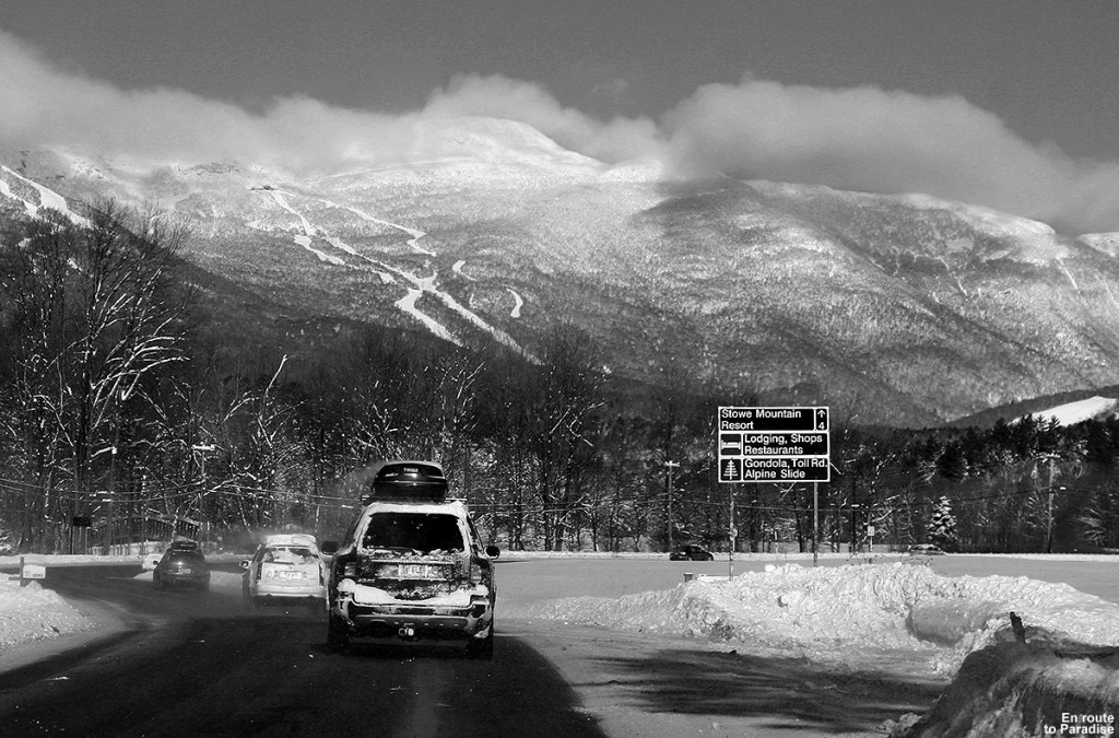 An image of Mt. Mansfield and some of Stowe Mountain Resort's snowy ski trails as we approach on the Mountain Road