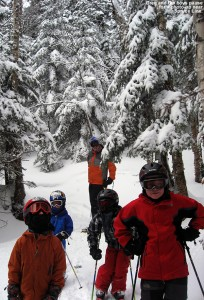 An image of Greg and the boys stopping in the powdery woods for a photo during one of our trips on the Sensation Quad at Stowe Mountain Ski Resort in Vermont