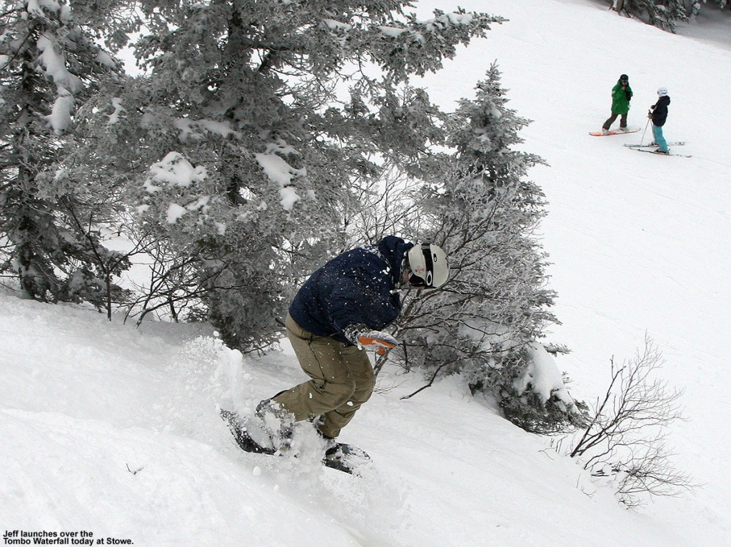 An image of Jeff jumping off the Tombo Waterfall on his snowboard at Stowe Mountain Ski Resort in Vermont