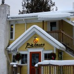 A winter image of the snow-covered exterior of Piecasso restaurant in Stowe, Vermont