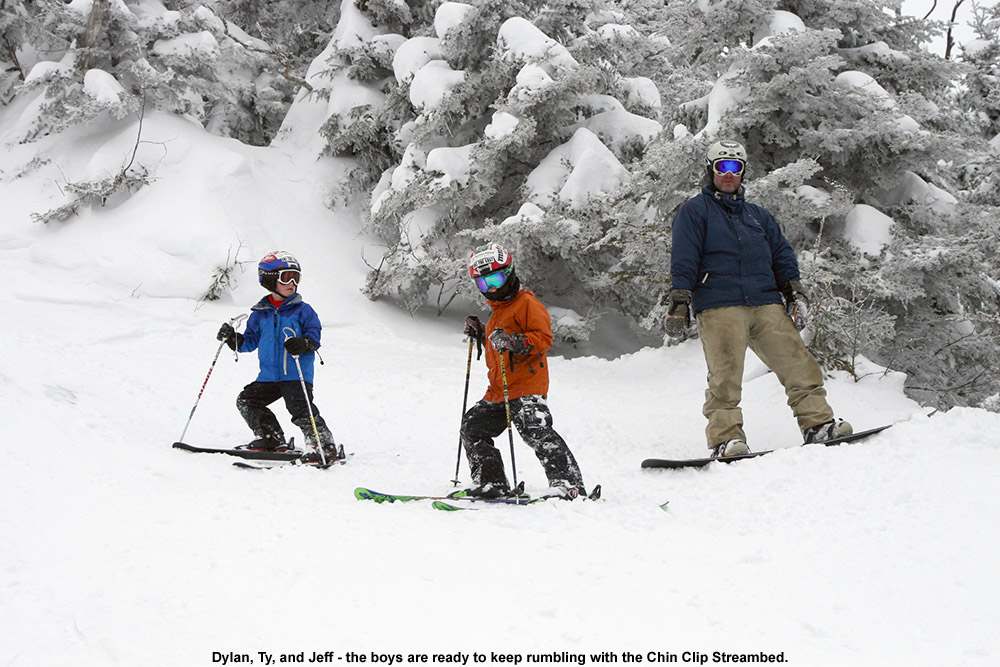 An image of Dylan, Ty, and Jeff standing in the Chin Clip Streambed during a run at Stowe Mountain Ski Resort in Vermont