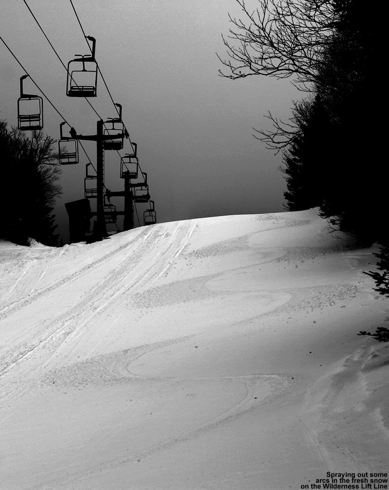 An image of ski tracks in a couple inches of powder on the Wilderness Lift Line trail at Bolton Valley Ski Resort in Vermont