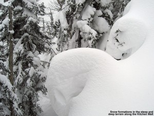 An image of deep pillows of snow along the Kitchen Wall Traverse at Stowe Mountain Ski Resort in Vermont