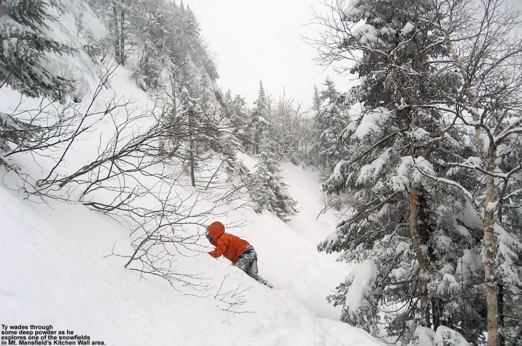 An image of Ty exploring deep snow in a steep snowfield in the Kitchen Wall area at Stowe Mountain Ski Resort in Vermont