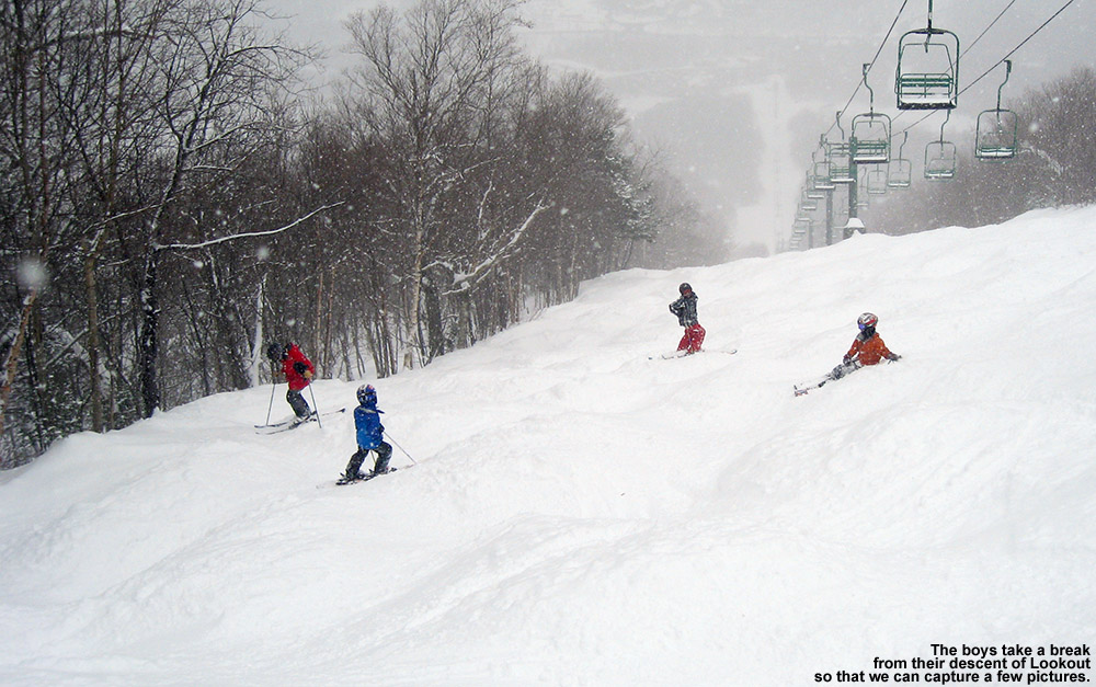 An image of Jack, Dylan, Luke, and Ty pausing on the Lookout trail at Stowe Mountain Ski Resort in Vermont