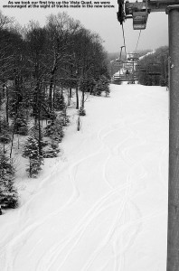 An image of ski tracks in the powder below the Vista Quad Chairlift at Bolton Valley Ski Resort in Vermont