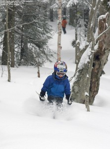An image of Dylan skiing fresh powder in the Villager Trees at Bolton Valley Ski Resort in Vermont