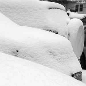 Snow-covered cars midday on a March powder day in the Wentworth Condominium area in the Bolton Valley Village