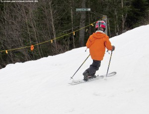 An image of Ty Telemark skiing in spring snow on Sherman's Pass at Bolton Valley Ski Resort in Vermont