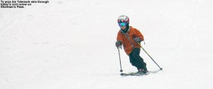An image of Ty arcing through a Telemark turn in spring snow on Sherman's Pass at Bolton Valley Ski Resort in Vermont