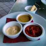 An image of homemade sauces accompanying Erica's cheeseburger at the Crop Bistro & Brewery in Stowe, Vermont
