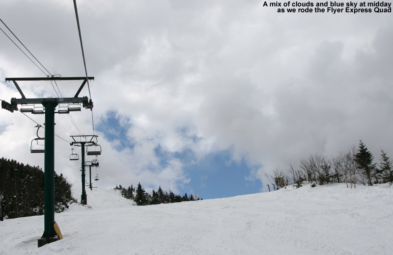 An image of blue skies and fresh snow viewed while riding the Flyer Express Quad at Jay Peak Ski Resort in Vermont