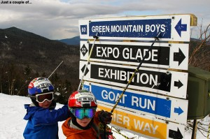 "Ty and Dylan point to one of the trail signs for the ""Green Mountain Boys"" trail at Jay Peak Ski Resort in Vermont"