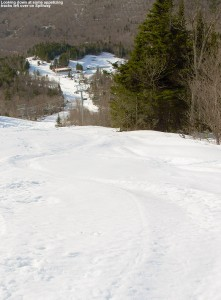 An image of recent ski tracks in the snow left by a recent April snowstorm on the steep Spillway trail at Bolton Valley Ski Resort in Vermont