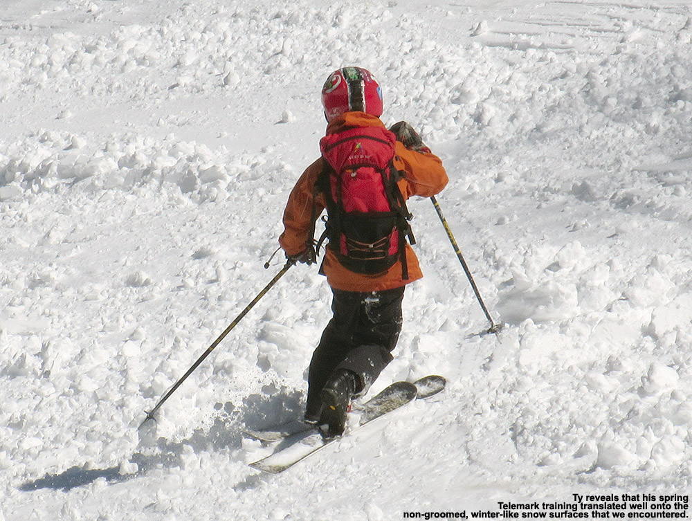 An image of Ty Telemark skiing in some tracked snow at Stowe Mountain Resort in Vermont after an April snowstorm