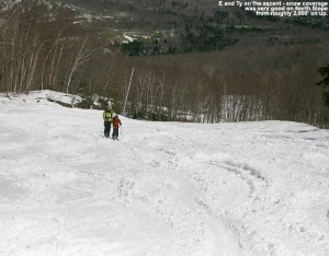 An image of E and Ty skinning up the North Slope trail at Stowe Mountain Resort in Vermont to get some turns after a recent April snowstorm