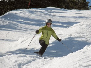An image of Erica Telemark skiing in the spring snow at Stowe Mountain Resort in Vermont on March 31, 2012