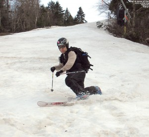 An image of Jay Telemark skiing in May on the Haynes Trail at Jay Peak Resort in Vermont