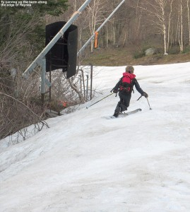 An image of Ty making a Telemark turn on the Haynes Trail at Jay Peak Resort in Vermont in mid May