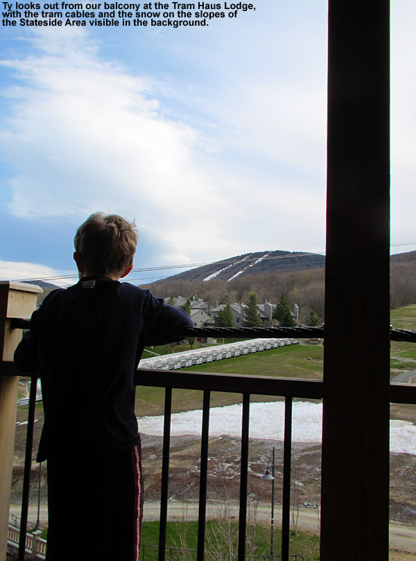 An image of Ty looking out from the balcony of our room in the Tram Haus Lodge at Jay Peak Ski Resort in Vermont