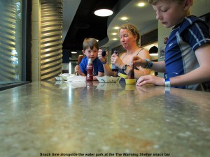 An image of Dylan, Erica, and Ty having lunch at The Warming Shelter snack bar next to the water park at Jay Peak Ski Resort in Vermont