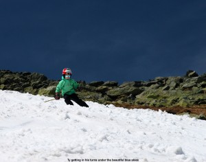 An image of Ty skiing under beautiful blue skies on the Mount Washington snowfields on Memorial Day Weekend 2012