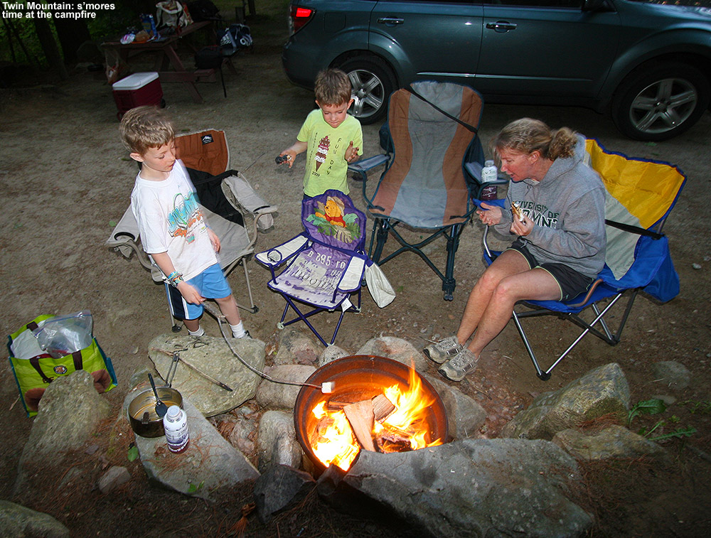An image of Erica, Ty, and Dylan around a campfire making s'mores at the Twin Mountain KOA campground in New Hampshire on Memorial Day weekend 2012