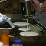 An image of pancake batter being dispensed for the all-you-can-eat breakfast at the Twin Mountain, New Hampshire KOA Campground