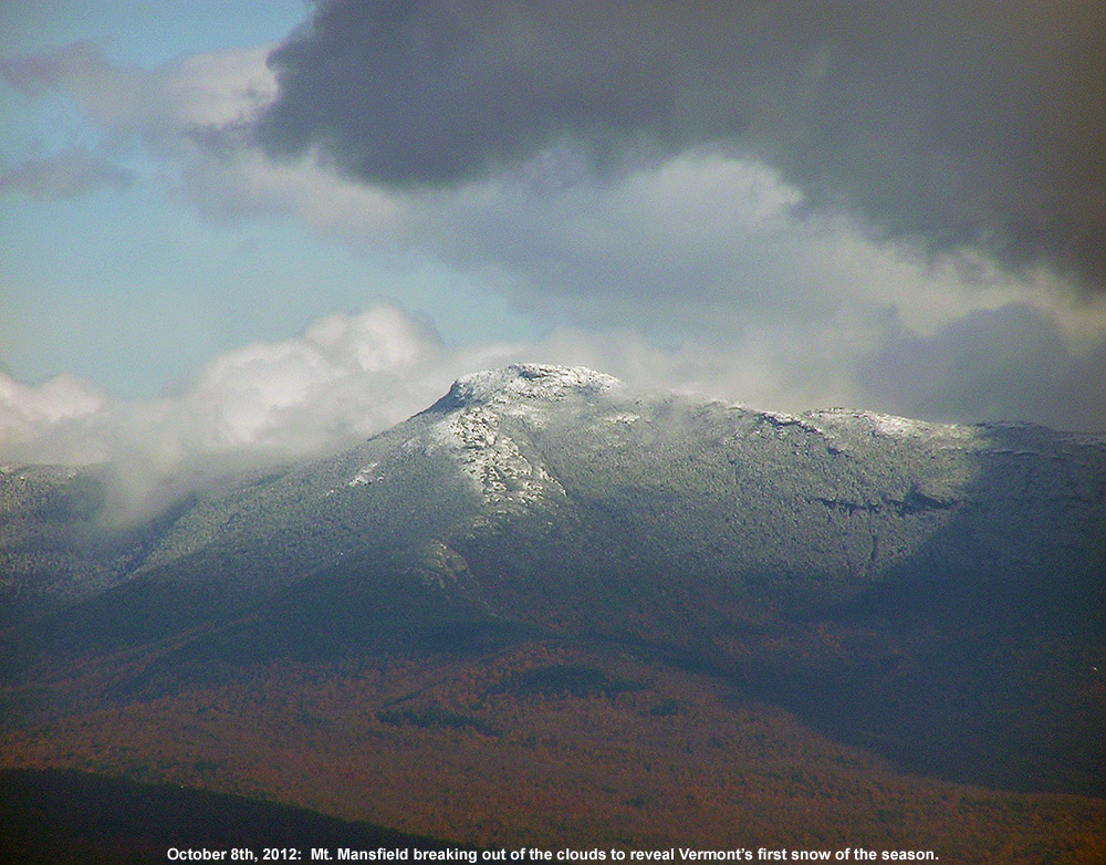 An image of Mt. Mansfield in Vermont taken from the Burlington area on October 8th, 2012 showing the first snowfall of the season on the peak with some of the fall foliage below