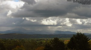 An image of Camel's Hump in Vermont with snowfall just starting to appear around it