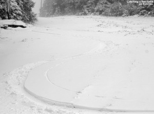 An image showing ski tracks on the Sunrise trail at Stowe Mountain Resort in Vermont after an early November snowfall