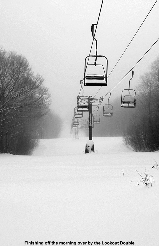 An image of the Lookout Double Chairlift with fresh powder below it at Stowe Mountain Resort in Vermont