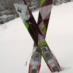 An image of my Black Diamond AMPerage powder skis sitting in snow while I get ready for a descent at Stowe Mountain Resort in Vermont