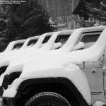 An image showing the driving school vehicles at Bolton Valley with a fresh coating of snow