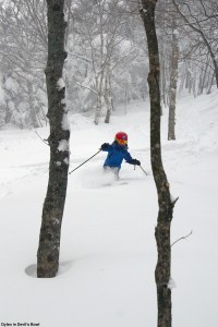 An image of Dylan skiing some powder in the Devil's Bowl area at Bolton Valley Ski Resort in Vermont