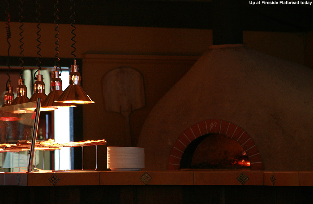 An image of the wood-fired pizza oven at Fireside Flatbread restaurant in the base lodge of Bolton Valley Ski Resort in Vermont