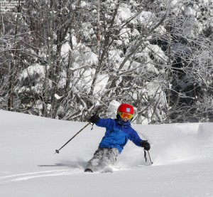 An image of Dylan skiing some nor'easter powder on the Spell Binder trail at Bolton Valley Resort in Vermont