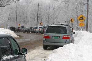 An image of cars parked along the Bolton Valley Access Road  after the upper parking lots at Bolton Valley Ski Resort were filled