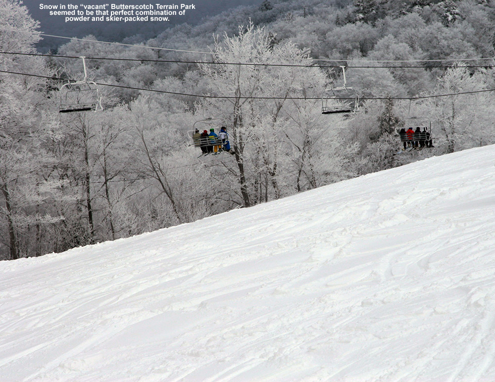 An image of the Butterscotch Terrain Park with chopped up powder and the Vista Quad Chairlift in the background at Bolton Valley Ski Resort in Vermont