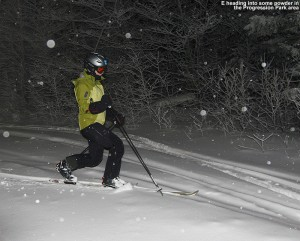 An image of Erica night skiing in a bit of powder in the Progression Terrain Park at Bolton Valley Ski Resort in Vermont