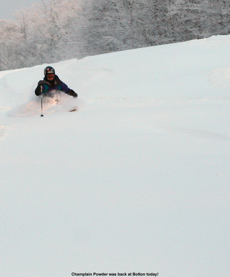 An image of Jay Telemark skiing in powder on the Showtime trail at Bolton Valley Ski Resort in Vermont